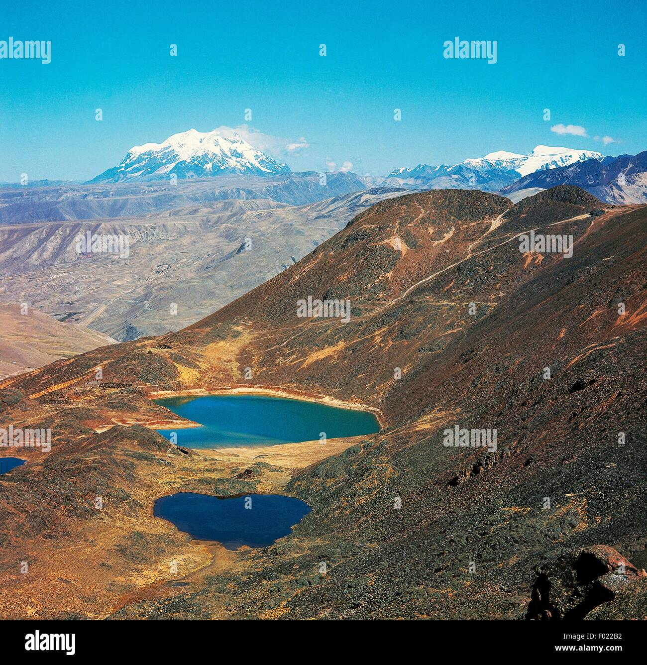 Ponds in the foreground and in the background Mount Illimani (6402 metres), Cordillera Real, eastern area of the - Stock Image