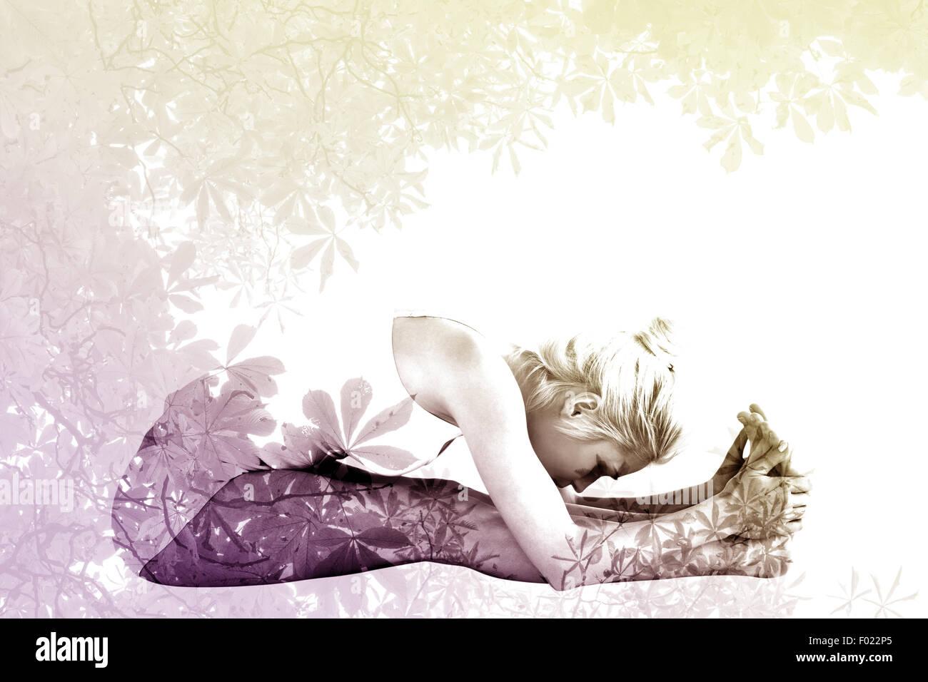 Composite image of toned woman doing the paschimottanasana pose - Stock Image