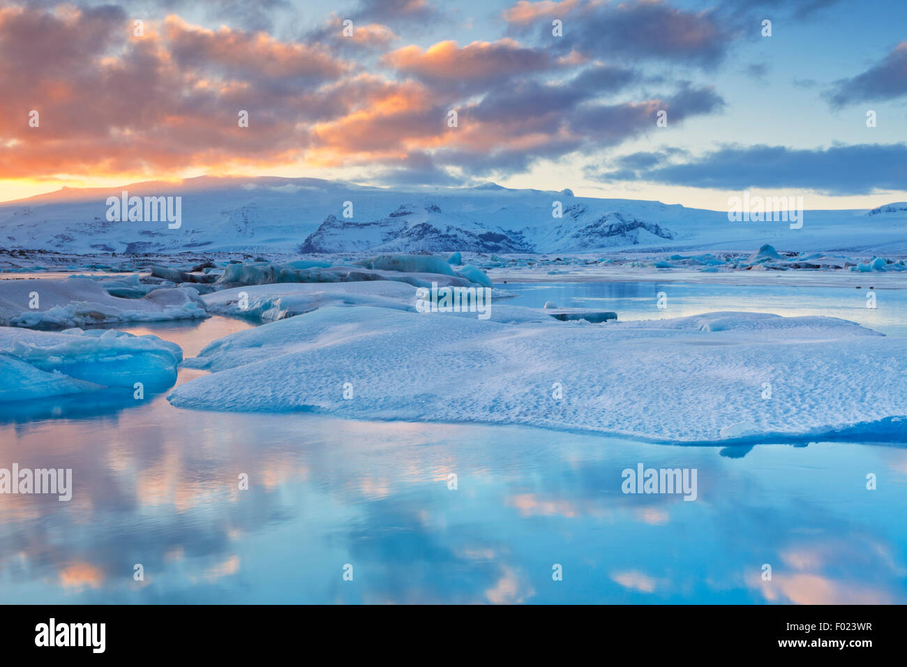 Icebergs in the Jökulsárlón glacier lake in Iceland in winter. Photographed at sunset. - Stock Image