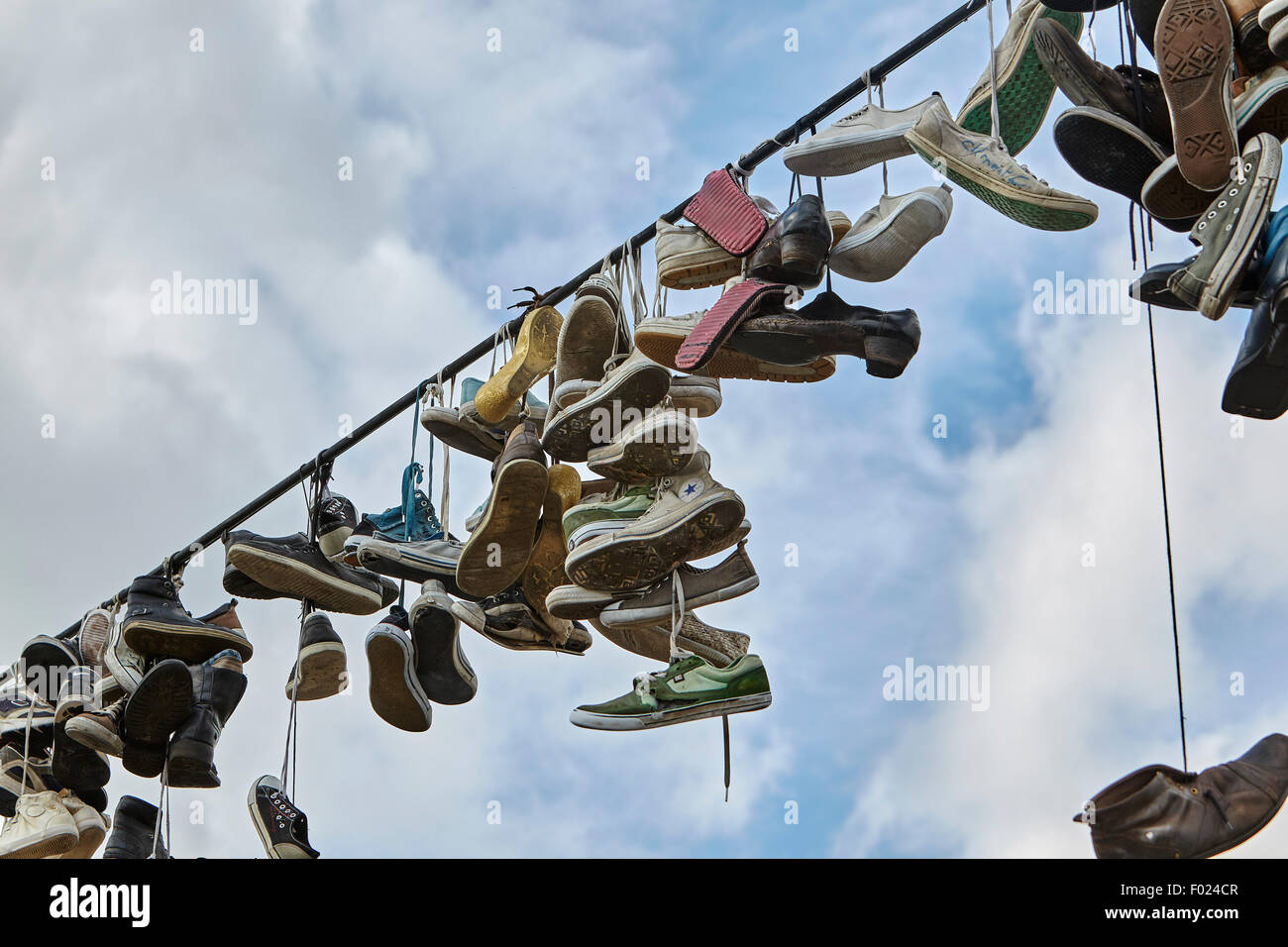 Shoes hanging from a wire, Letna Park, Prague, Czech Republic - Stock Image