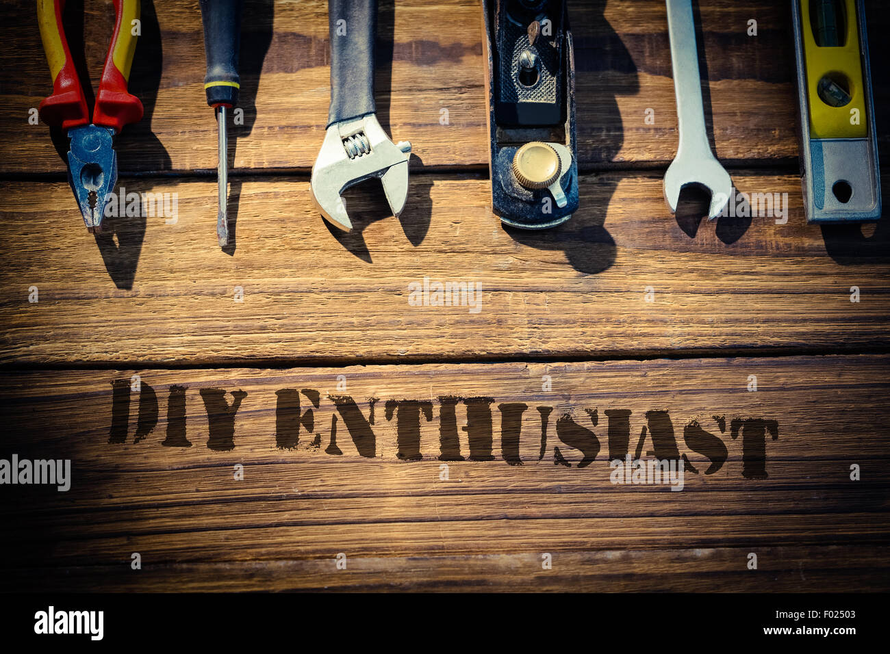 Diy enthusiast against desk with tools - Stock Image