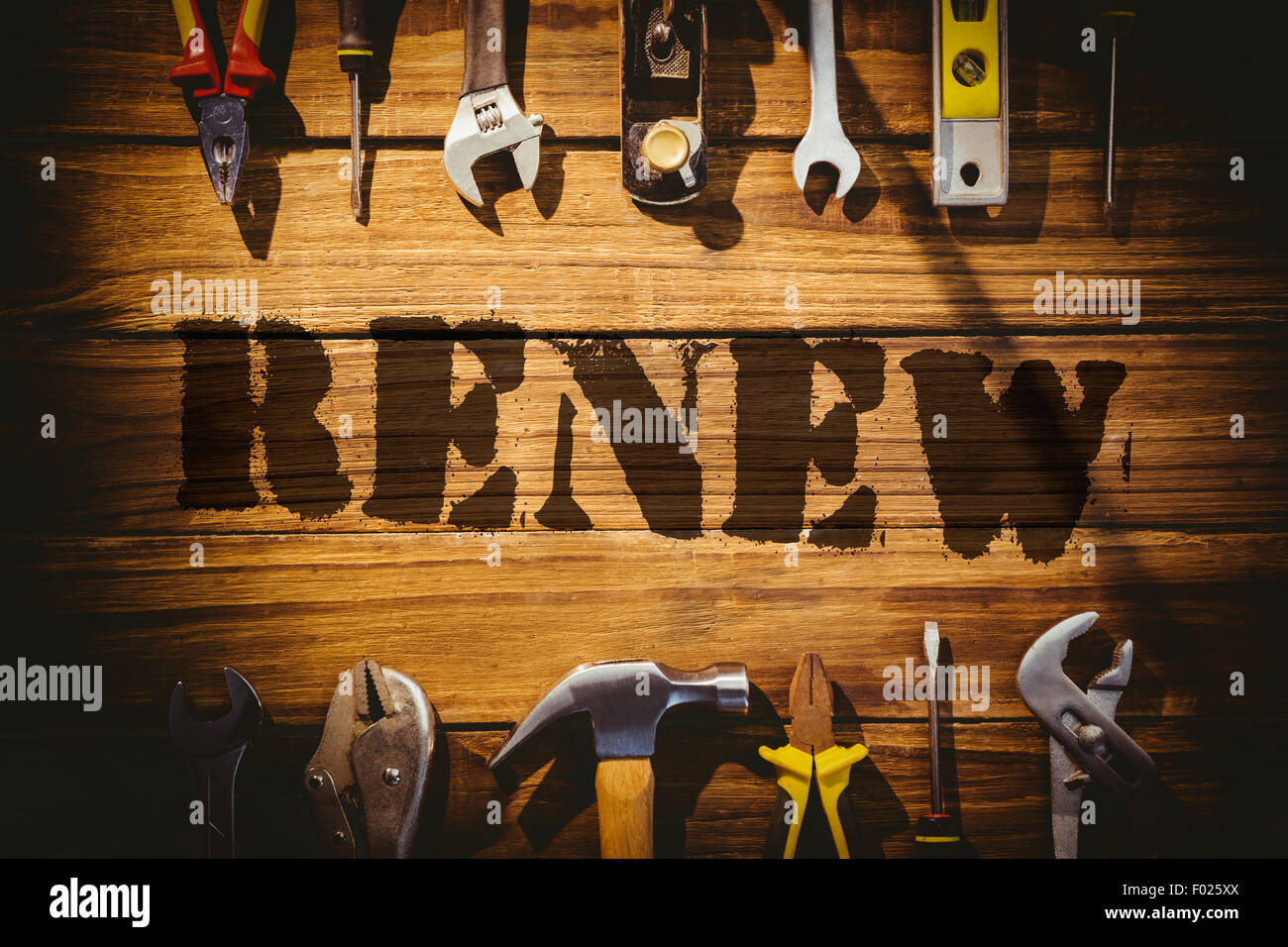 Renew against desk with tools - Stock Image
