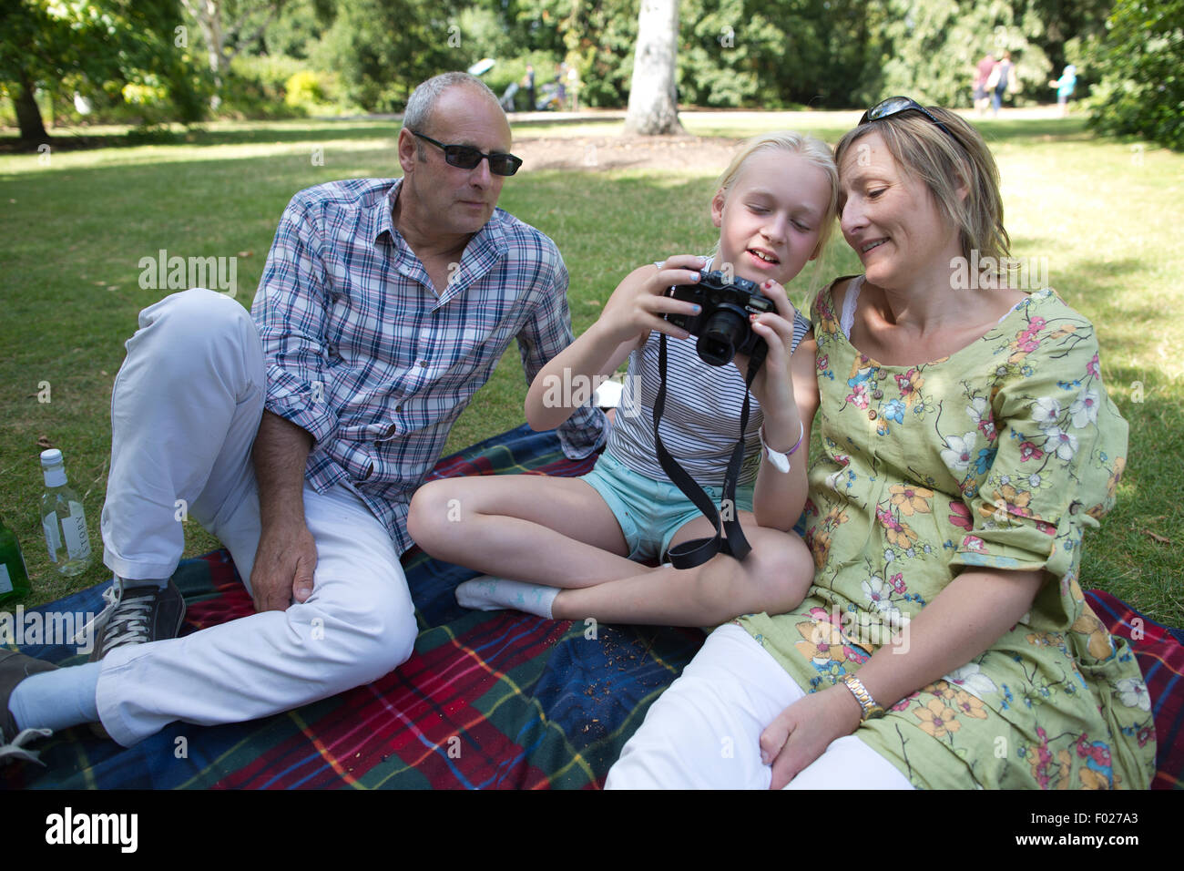 Family enjoying a relaxing day out at RHS Garden Wisley, Surrey, England, UK - Stock Image