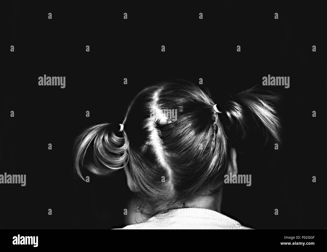 Rear view of a girl with pigtails - Stock Image