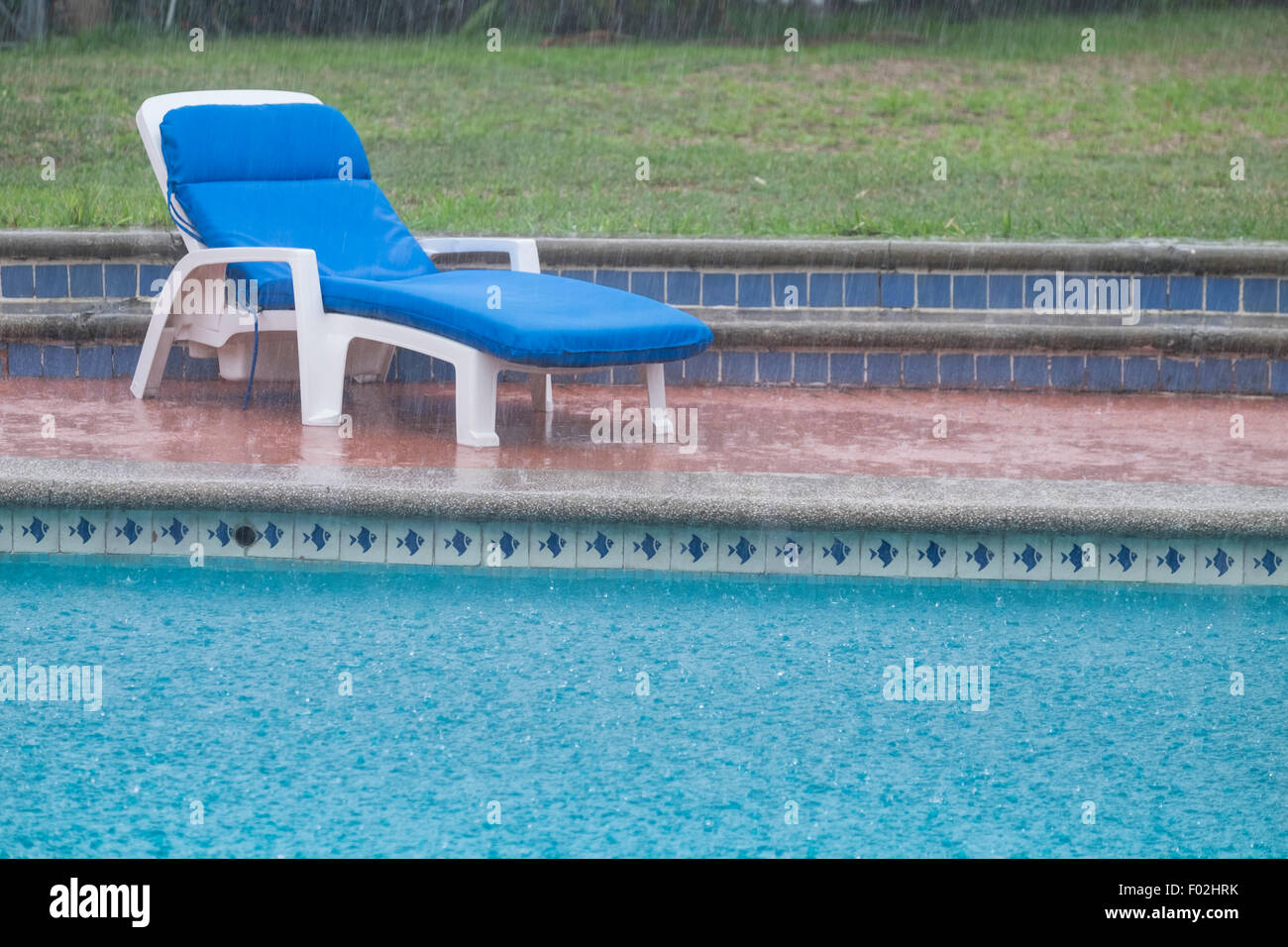 Heavy summer rain in residential backyard with swimming pool, Nayarit, Mexico - Stock Image