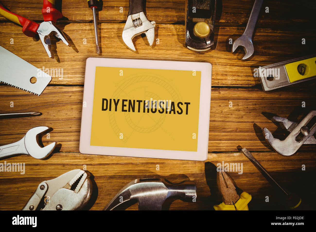 Diy enthusiast against blueprint - Stock Image