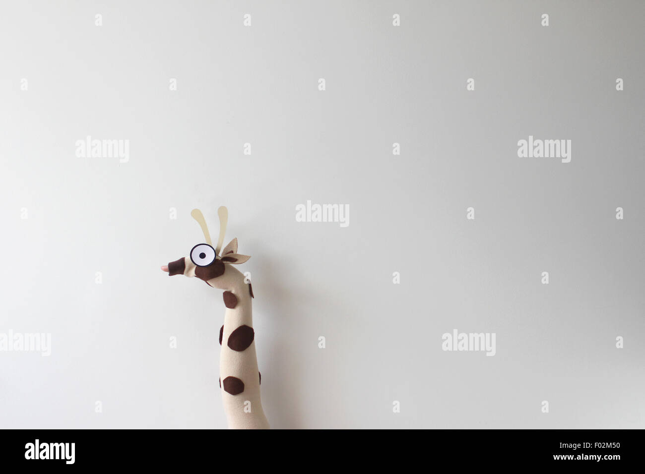 Giraffe hand puppet - Stock Image