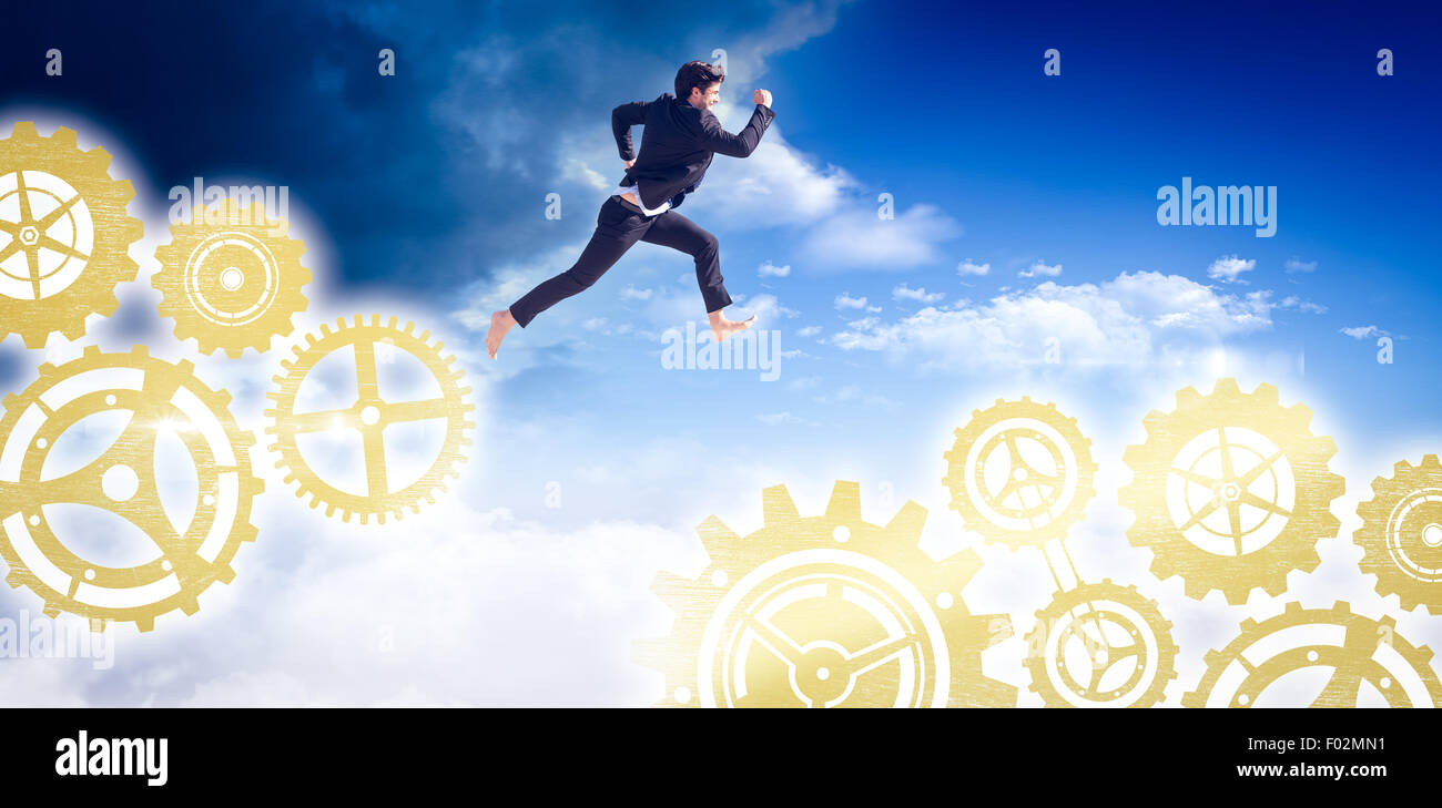 Composite image of businessman leaping - Stock Image