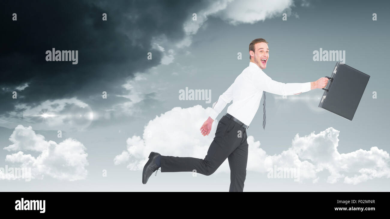 Composite image of happy businessman leaping with his briefcase - Stock Image