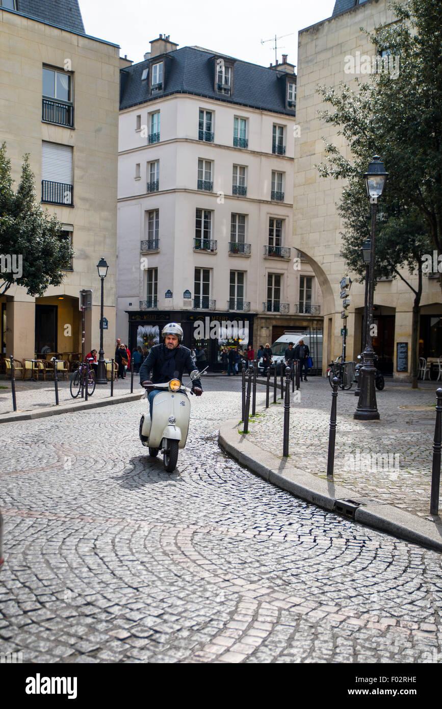 Man on a moped, Rue du Park Royal and Rue de la Perle, Paris - Stock Image