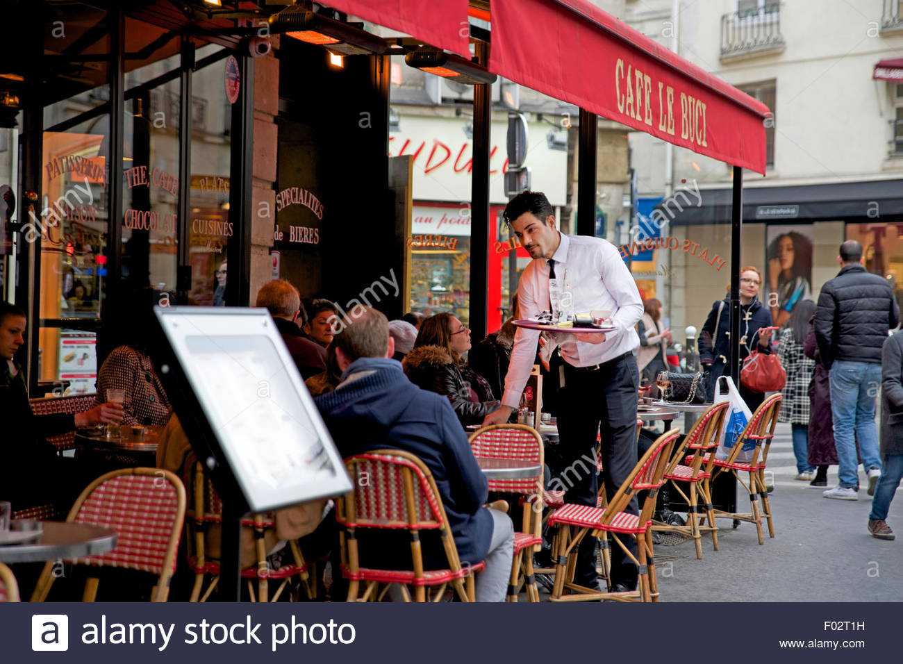 Waiter outside Le Cafe Buci, Paris - Stock Image