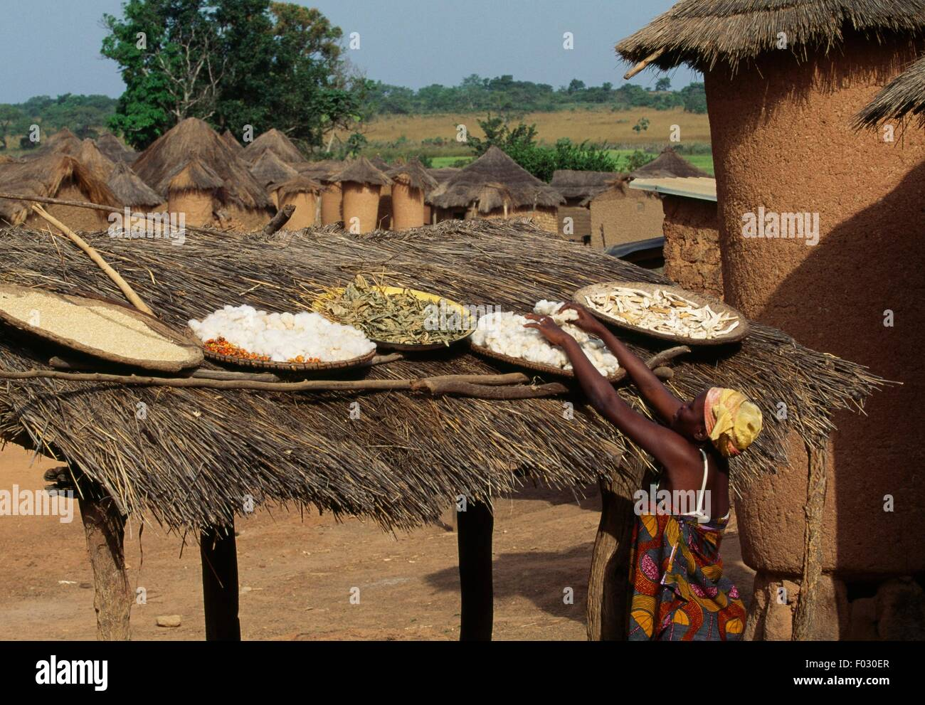 Food laid out in the sun on a straw roof, Senoufo, Ivory Coast. - Stock Image