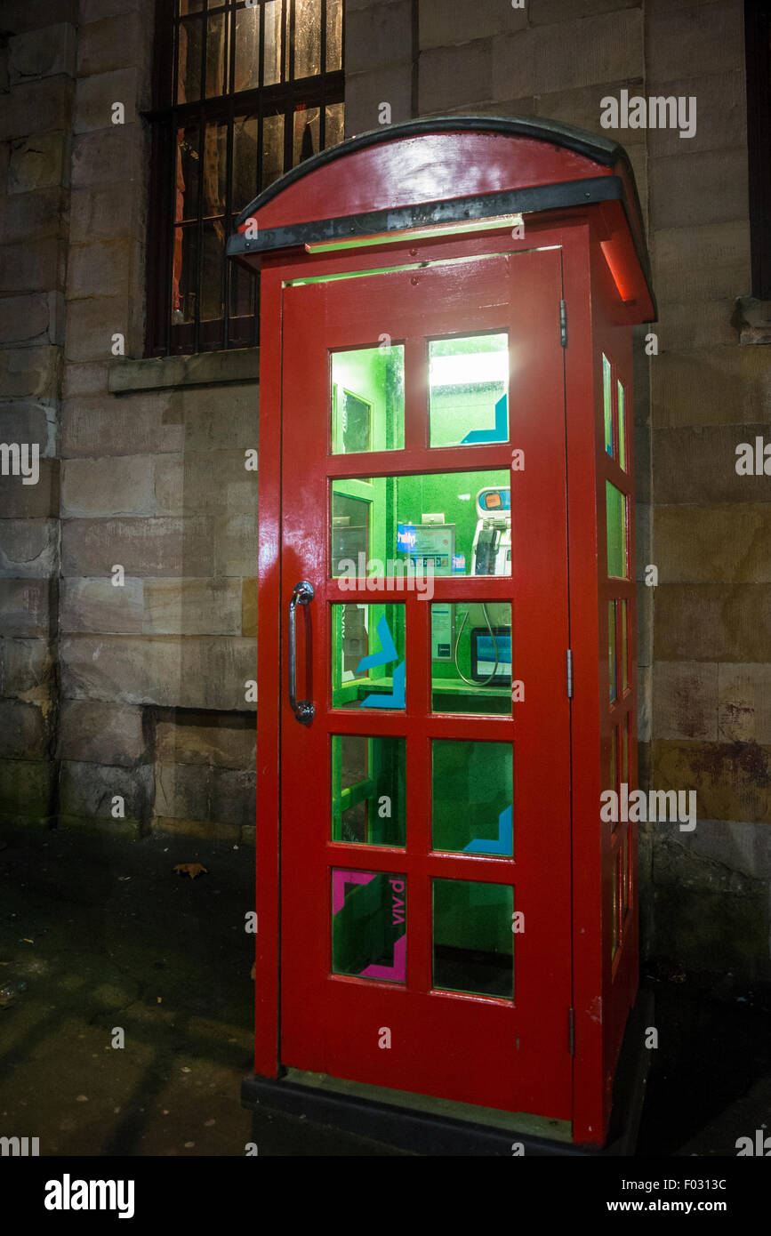 Red telephone box with green light, Sydney, Australia - Stock Image