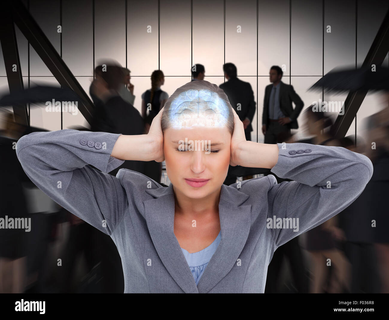 Composite image of close up of annoyed tradeswoman covering her ears - Stock Image
