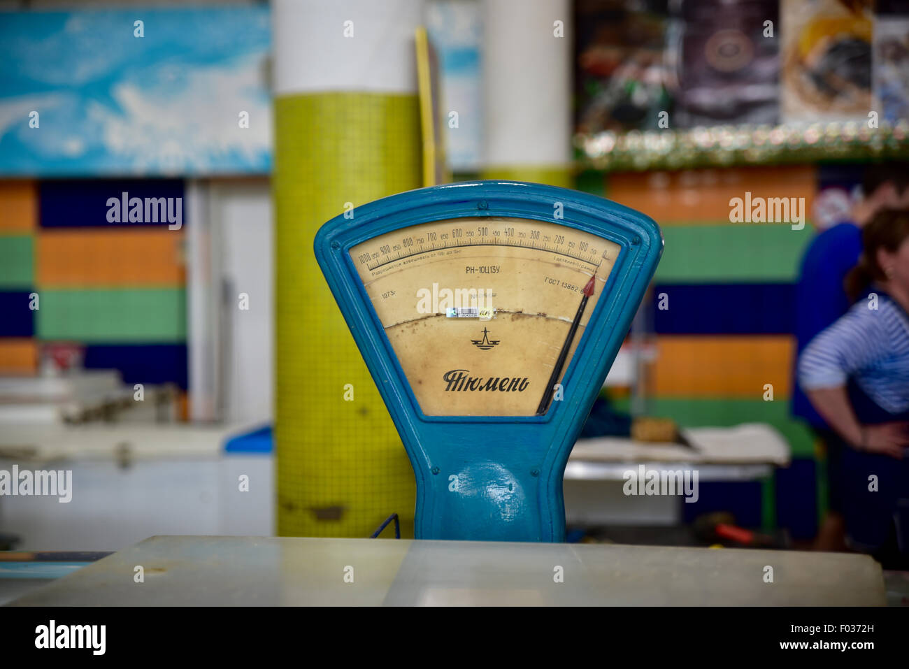 Vintage food scales in a Russian market - Stock Image