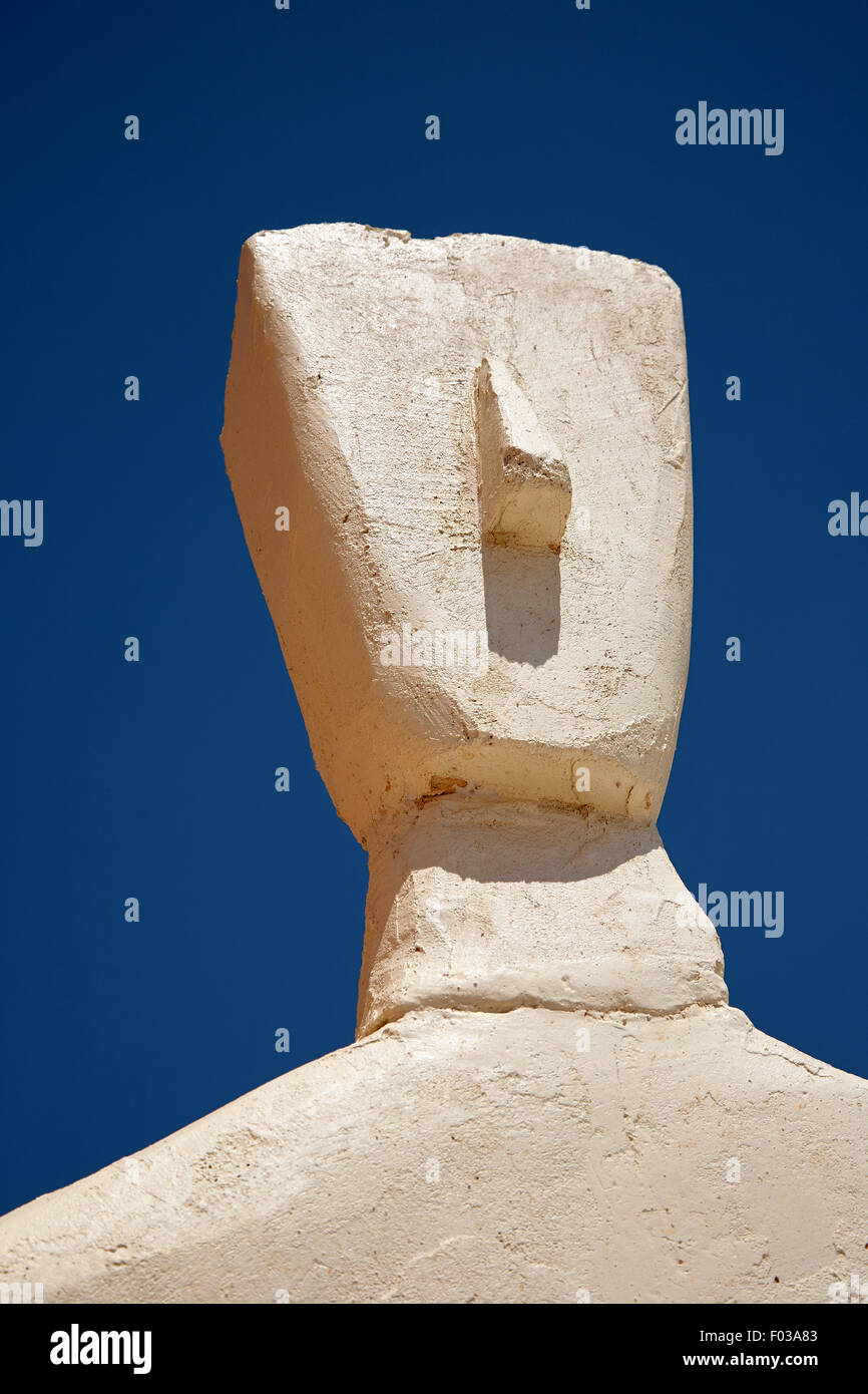 modern Greek statue of a head and shoulders outside against a blue sky - Stock Image