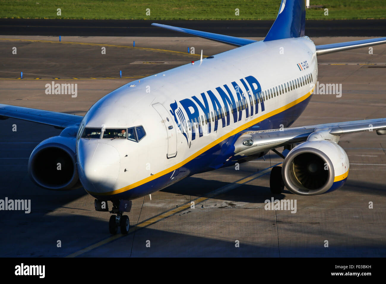 Ryanair Boeing 737-800 taxis to terminal 3 at Manchester airport. - Stock Image