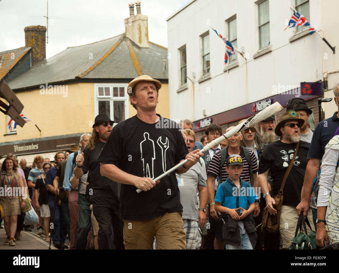 Spooky Men's Chorale flashmob Sidmouth town centre on the penultimate day of Folk Week festival, 2015 - Stock Image