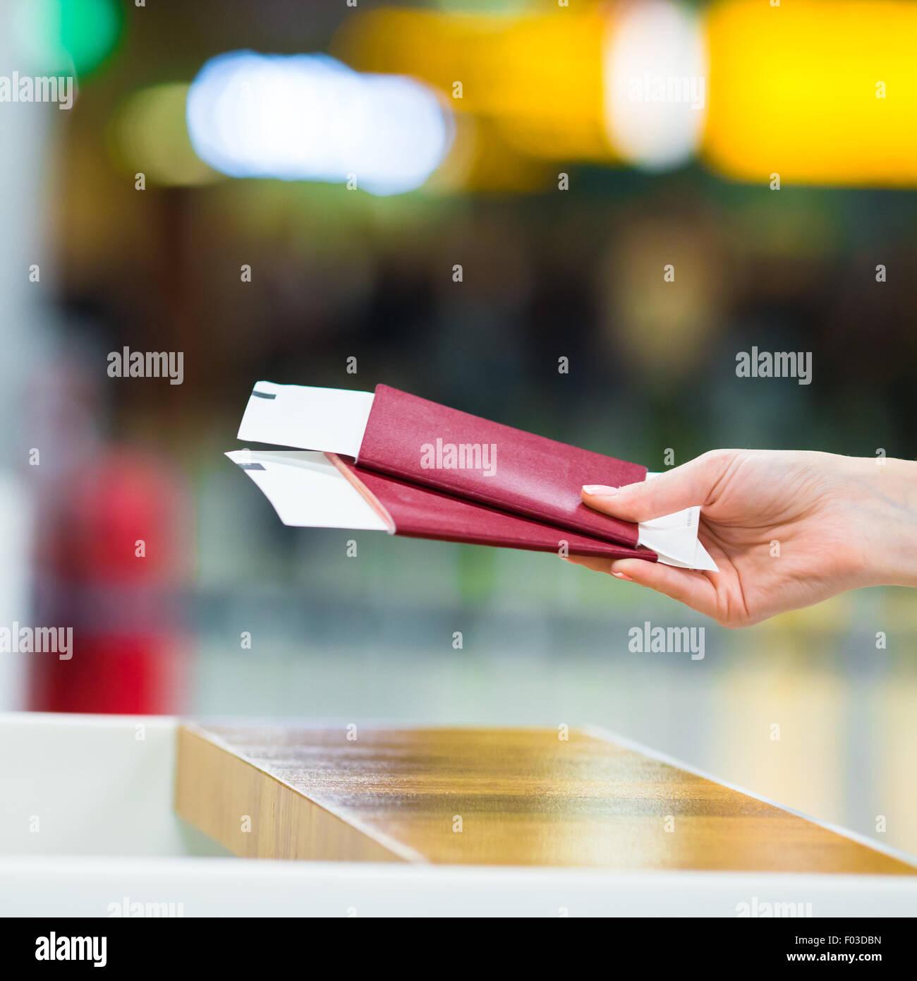 Closeup passports and boarding pass at airport indoor - Stock Image