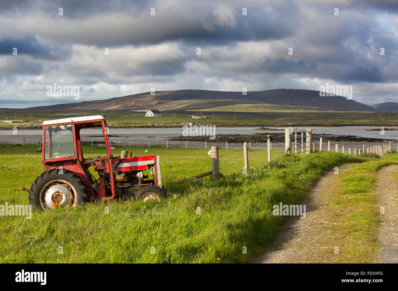 Old Massey Ferguson tractor on croft at Baile Mor North Uist Hebrides - Stock Image