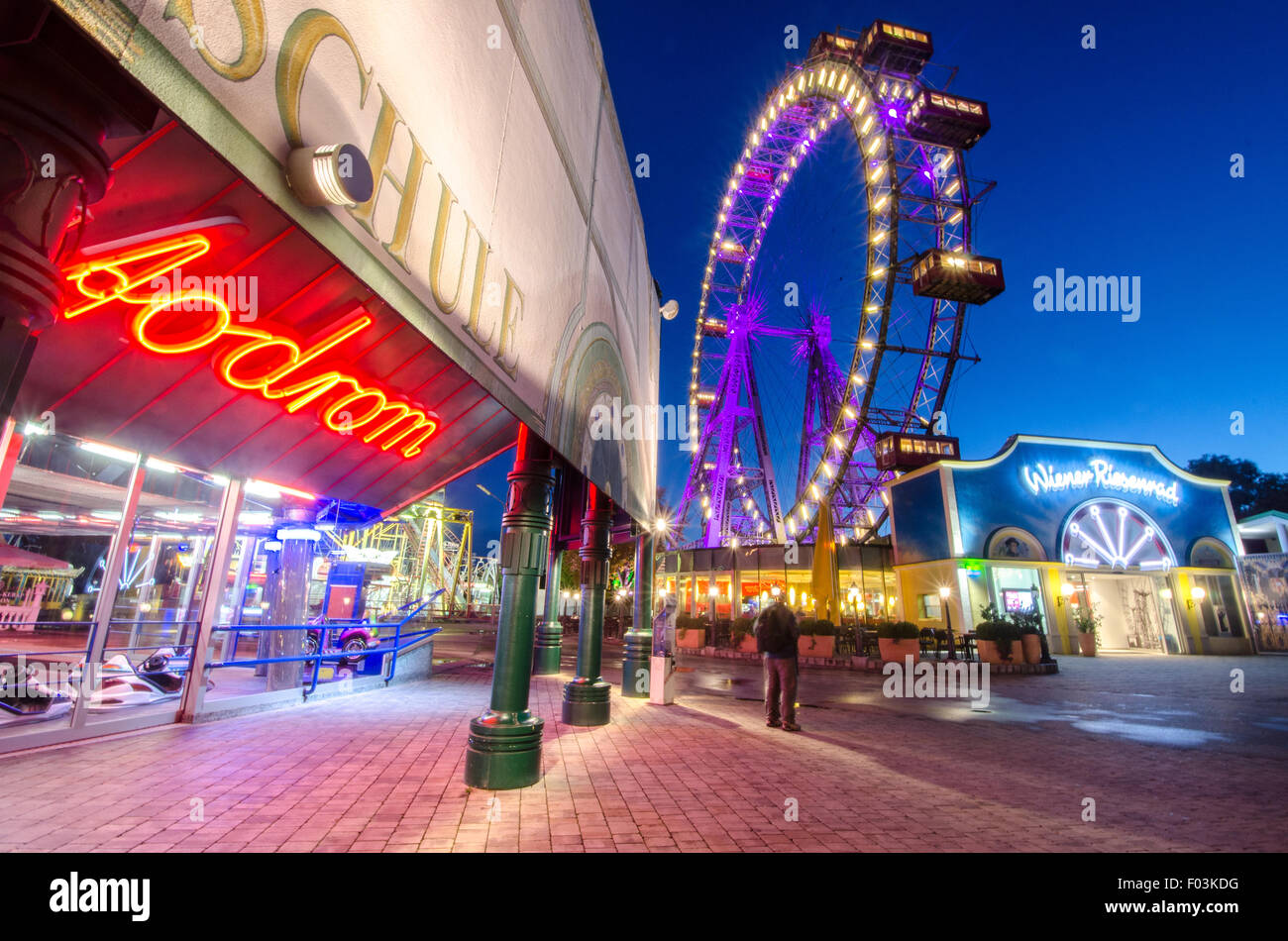 Riesenrad in Vienna with some night lights around. - Stock Image