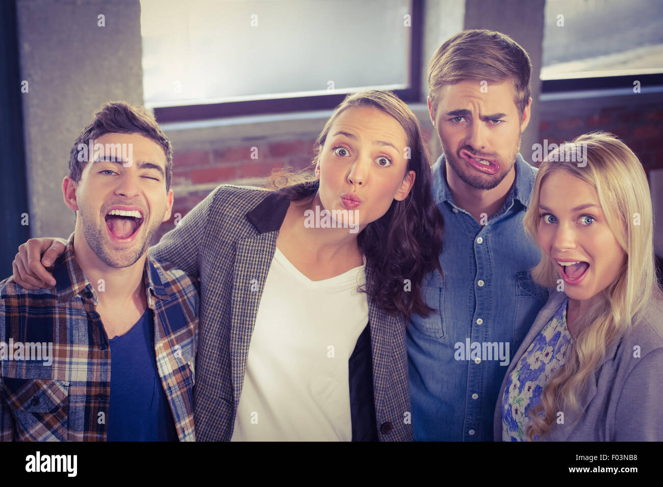 Grimacing friends having fun - Stock Image