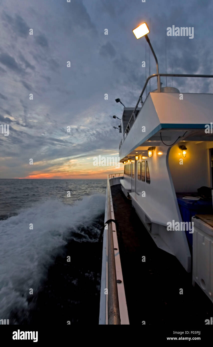 Vertical Sunset view on the ocean from a boat Stock Photo