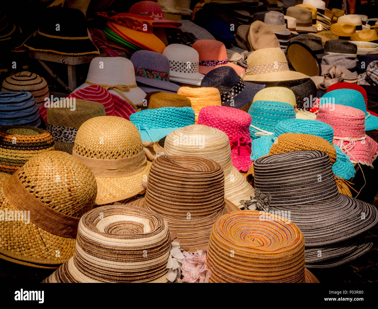 59ea8a5de0816 Stall selling ladies straw hats at Campo de  Fiori outdoor food market in  Rome.