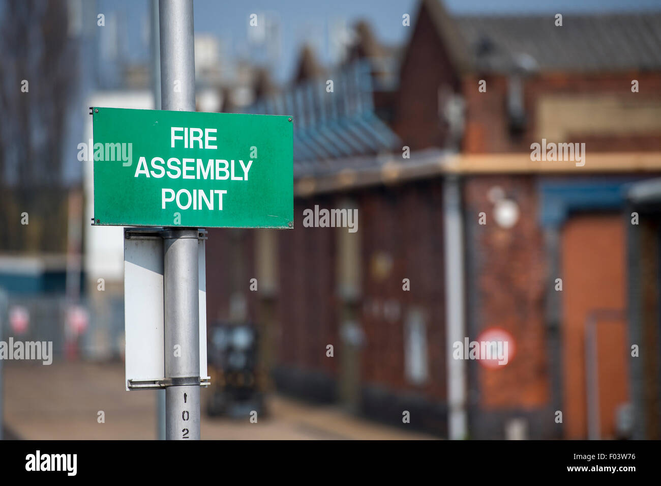 Fire Assembly Point sign outside business premises in England. - Stock Image