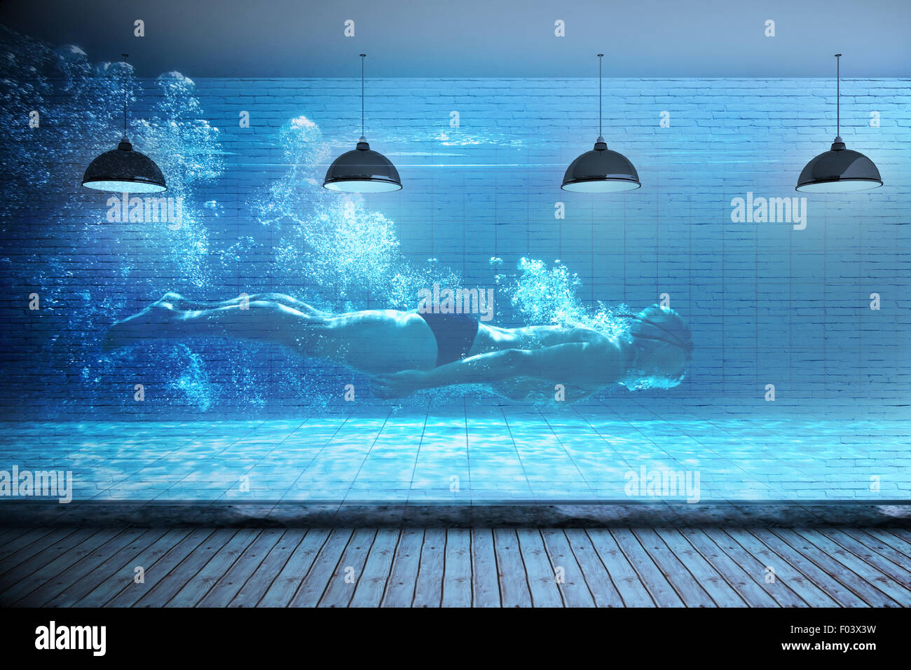 Composite image of fit swimmer training by himself - Stock Image