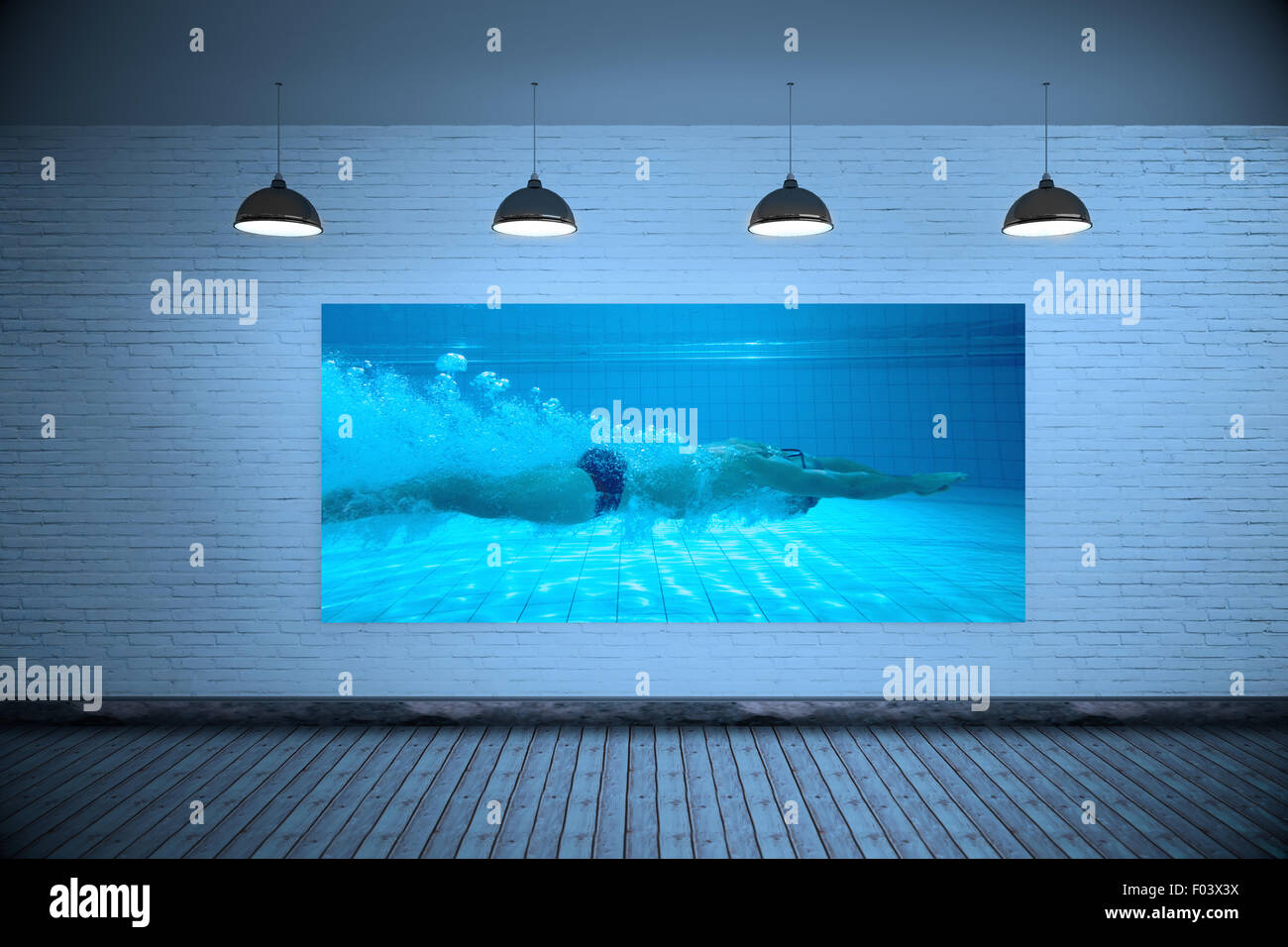 Composite image of fit swimmer training on his own - Stock Image