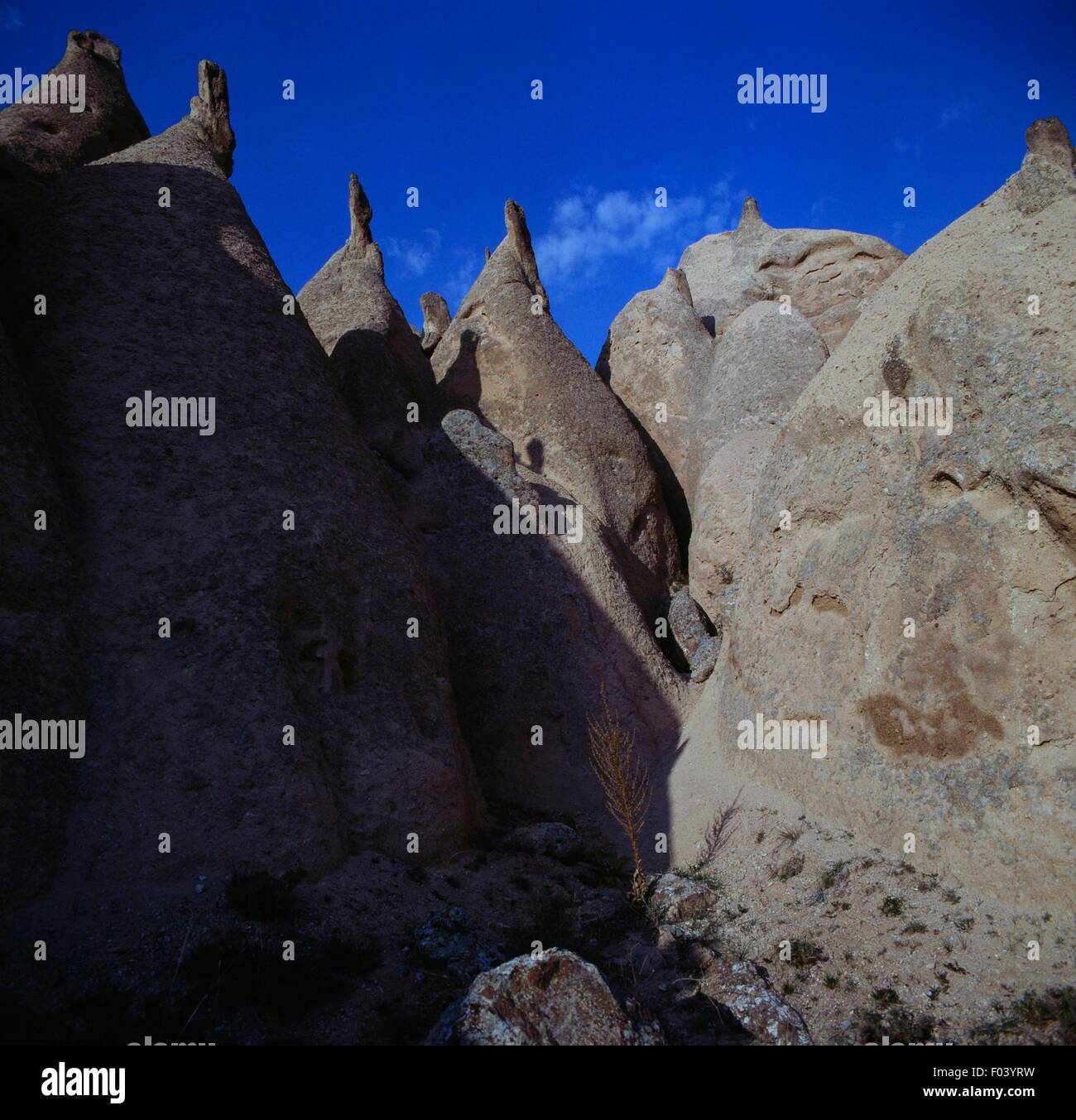The so-called Fairy Chimneys, pyramidal tuff formations, Cappadocia, Turkey. Stock Photo