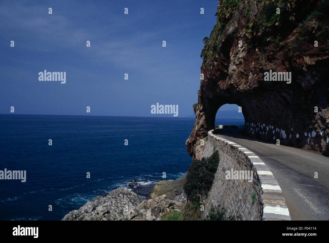 Rock-cut tunnel, coastal road, Bejaia, Algeria. Stock Photo