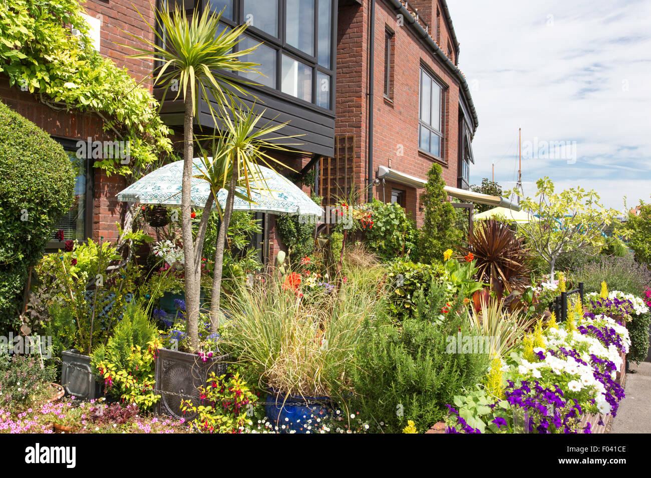 Colorful apartment gardens alongside Bristol Harbour, Bristol, England, UK - Stock Image