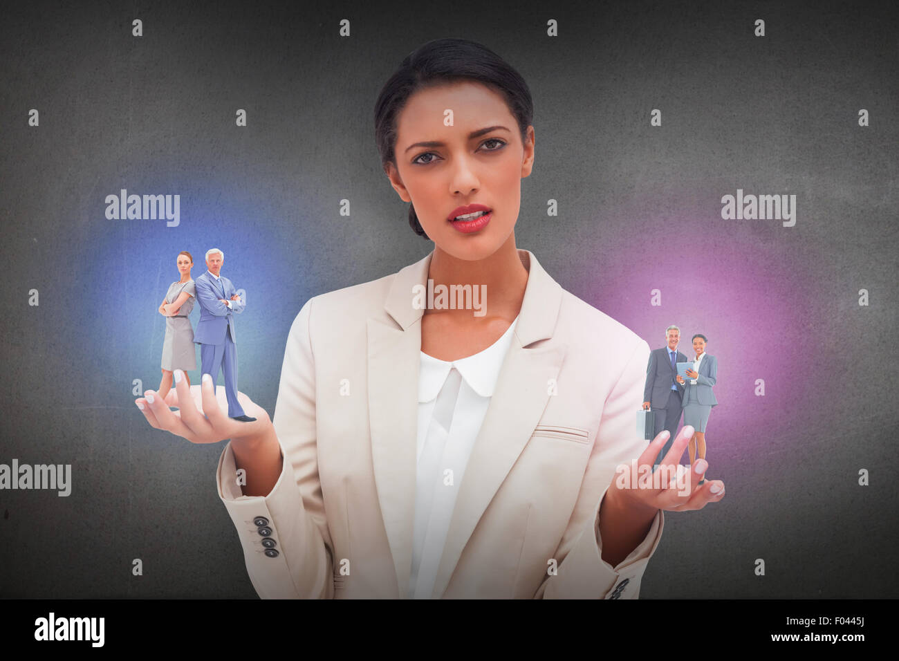 Composite image of serious businessman standing back to back with a woman - Stock Image