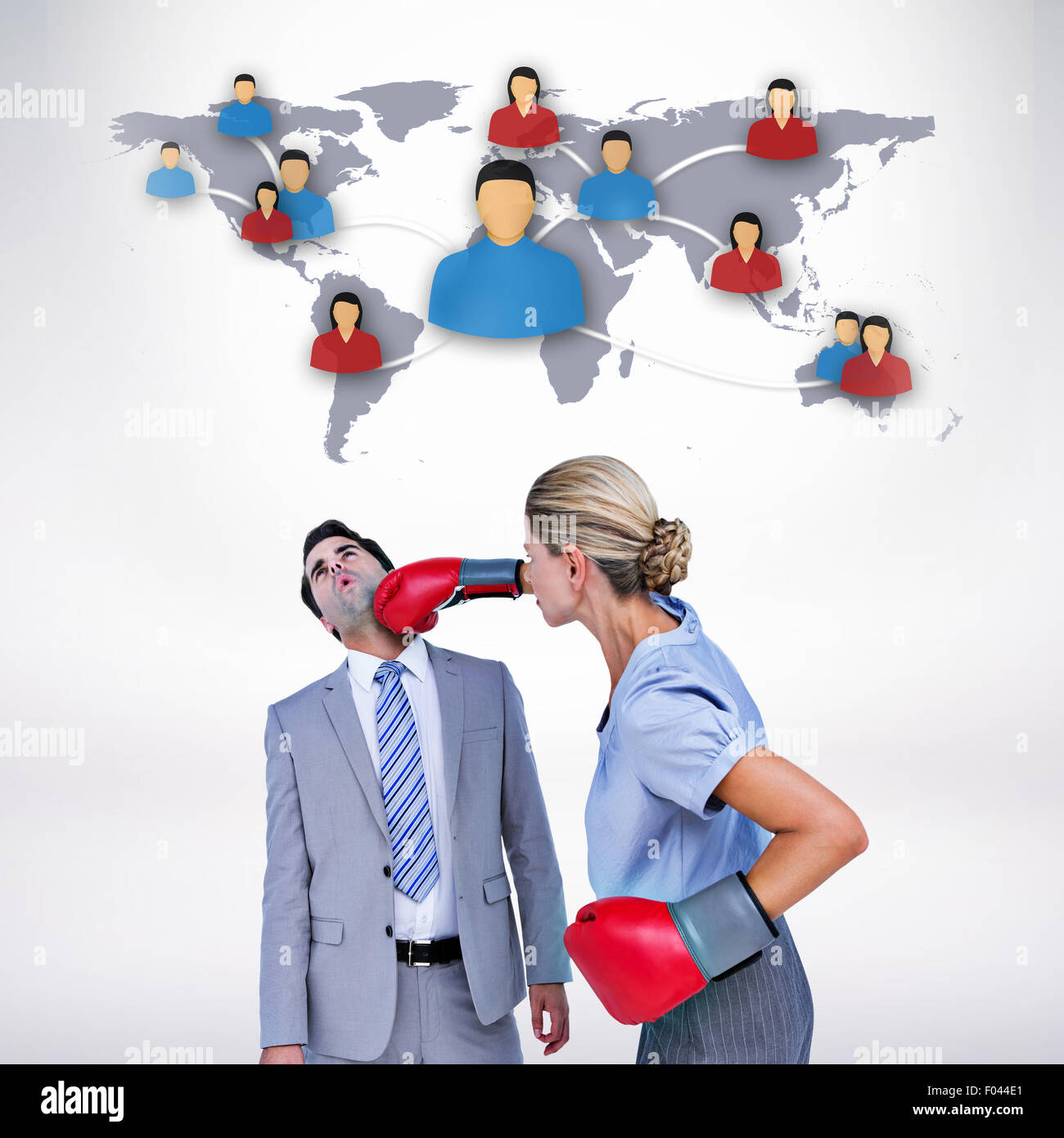 Composite image of businesswoman punching colleague with boxing gloves - Stock Image