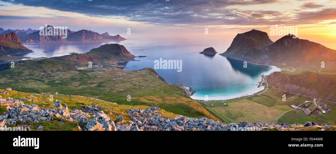 Norway. Panoramic view of  Lofoten Islands, located in Norway, taken from Holadsmelen, during summer sunset. - Stock Image