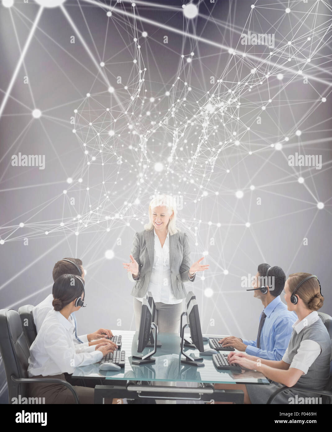 Composite image of smiling business people speaking together - Stock Image