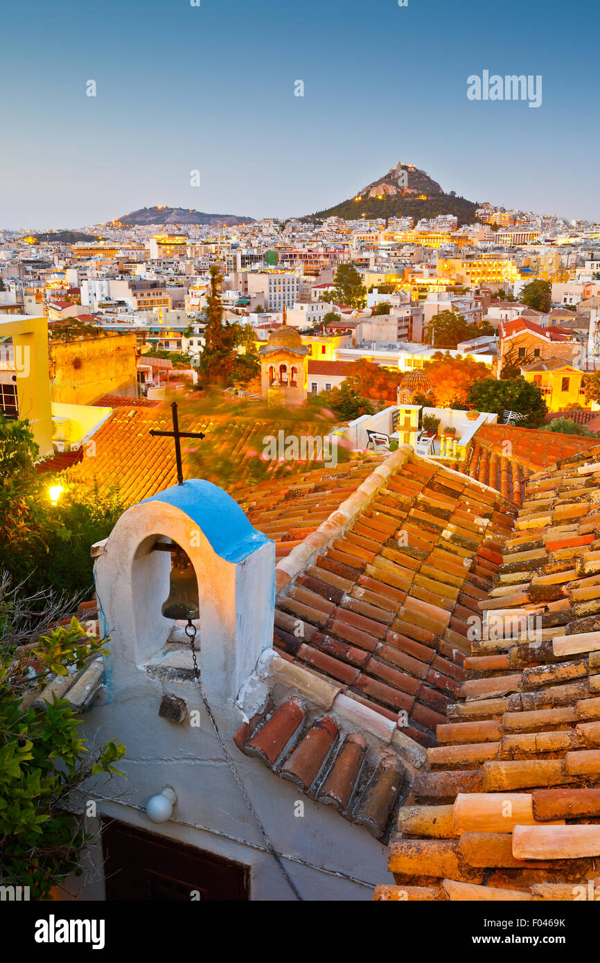 View of Lycabettus hill and a small Greek orthodox church in Anafiotika, Athens. Stock Photo