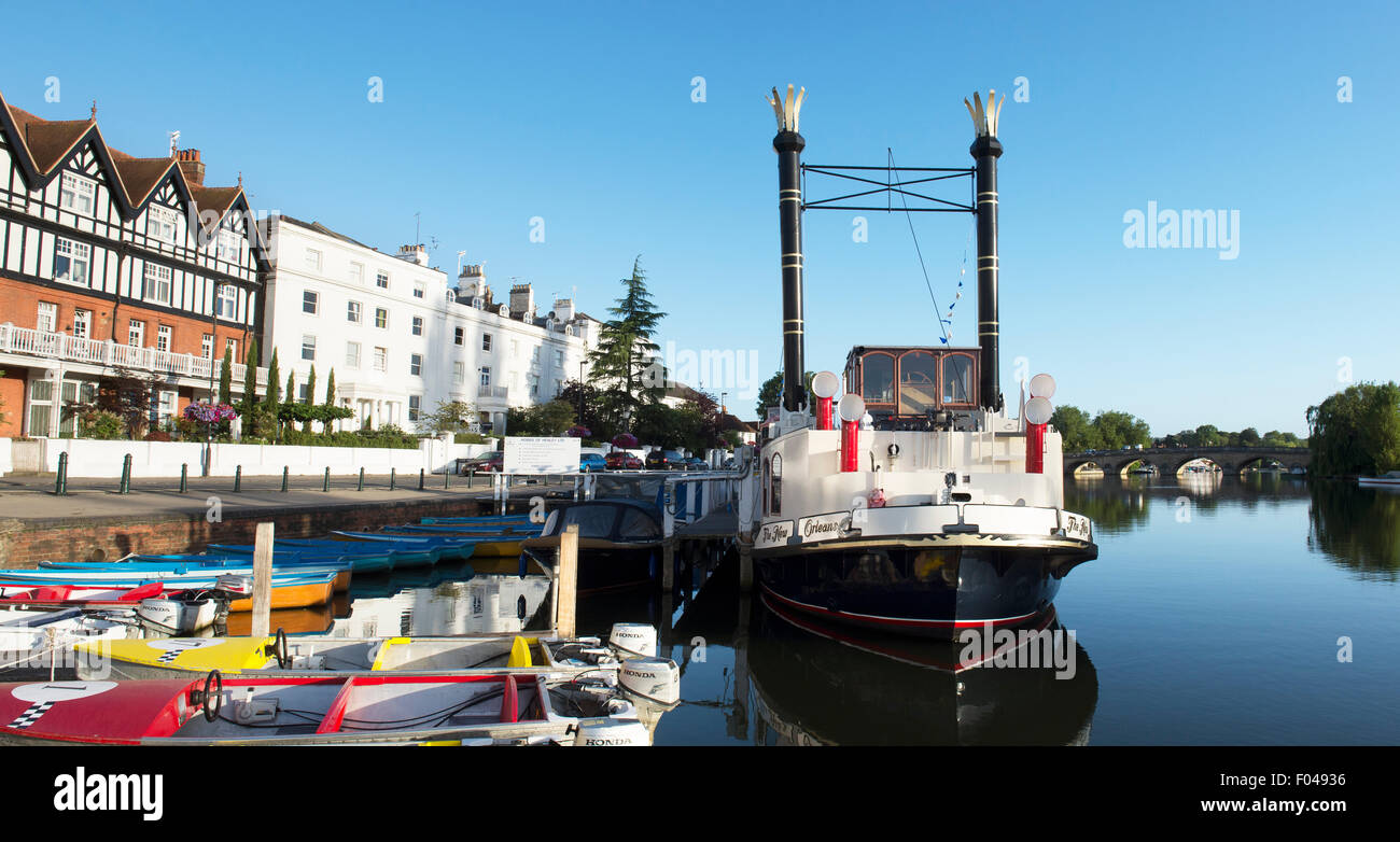Paddle steamer 'New Orleans' and hire boats on the river in the early morning light at Henley on Thames, Oxfordshire, Stock Photo