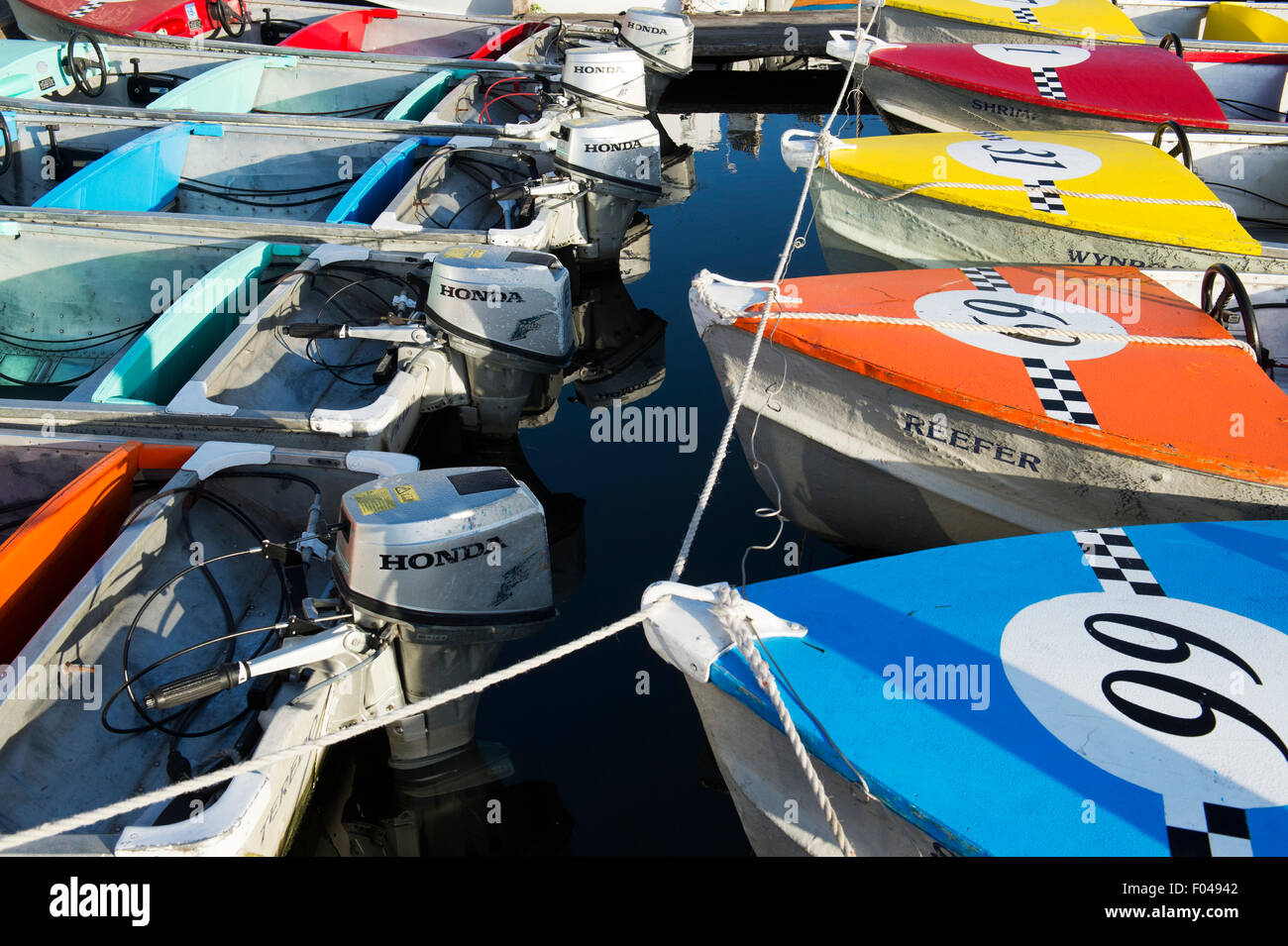 Hire outboard motorboats on the river in the early morning light at Henley on Thames, Oxfordshire, England - Stock Image