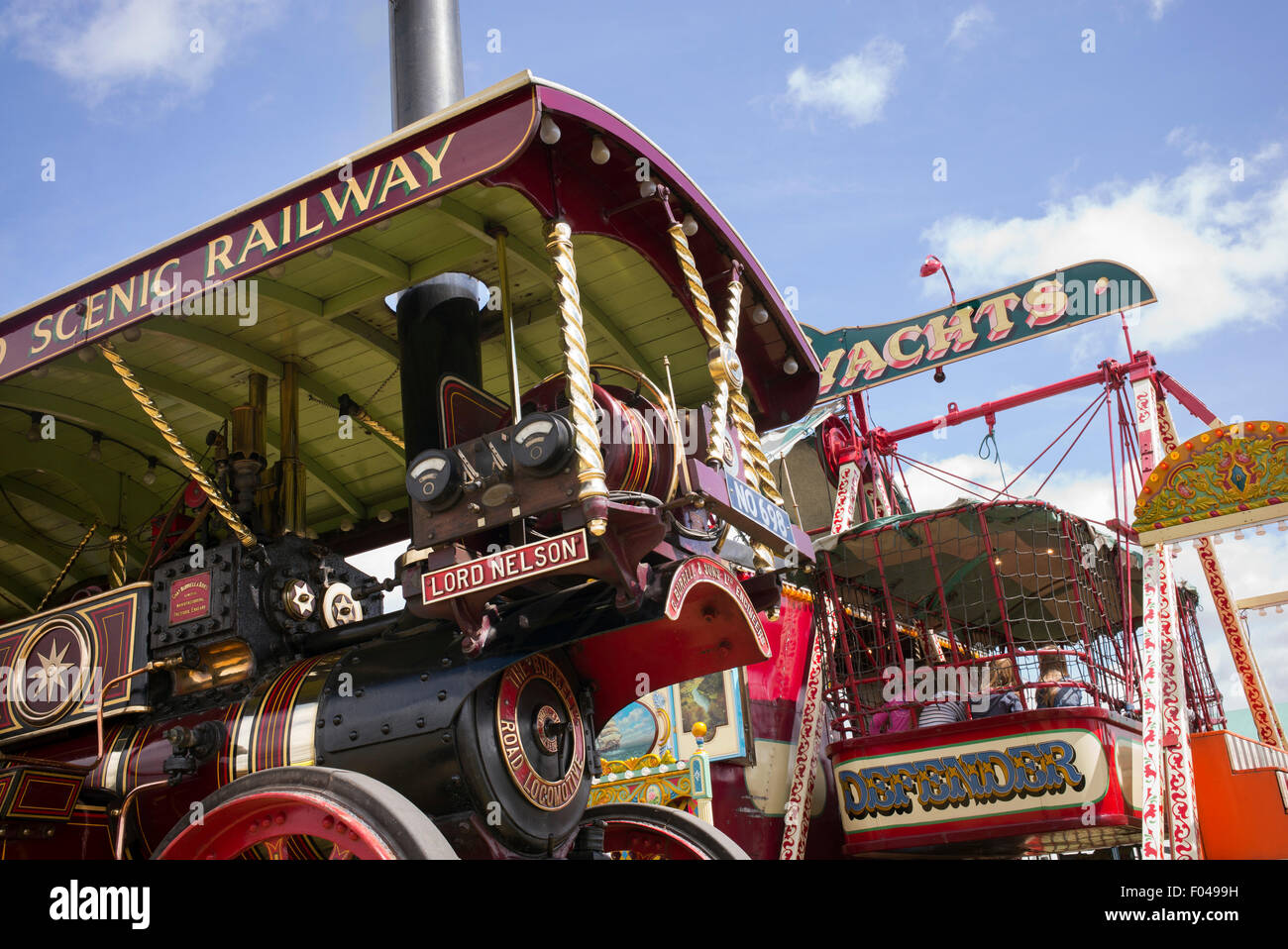 Showmans Traction Engine and fairground ride at a steam fair in England - Stock Image
