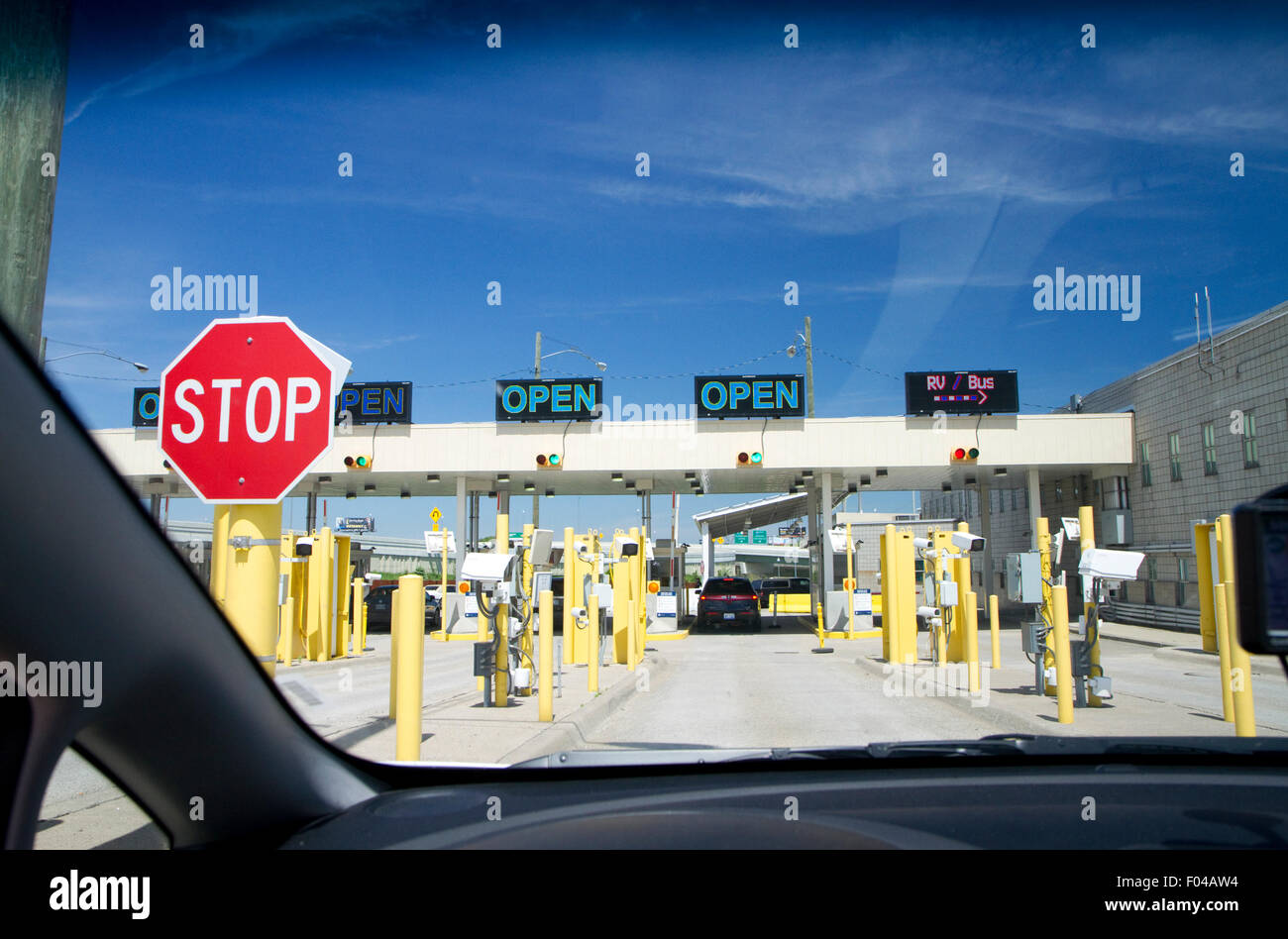U.S. customs checkpoint at Detroit, Michigan, USA returning from Ontario, Canada. - Stock Image