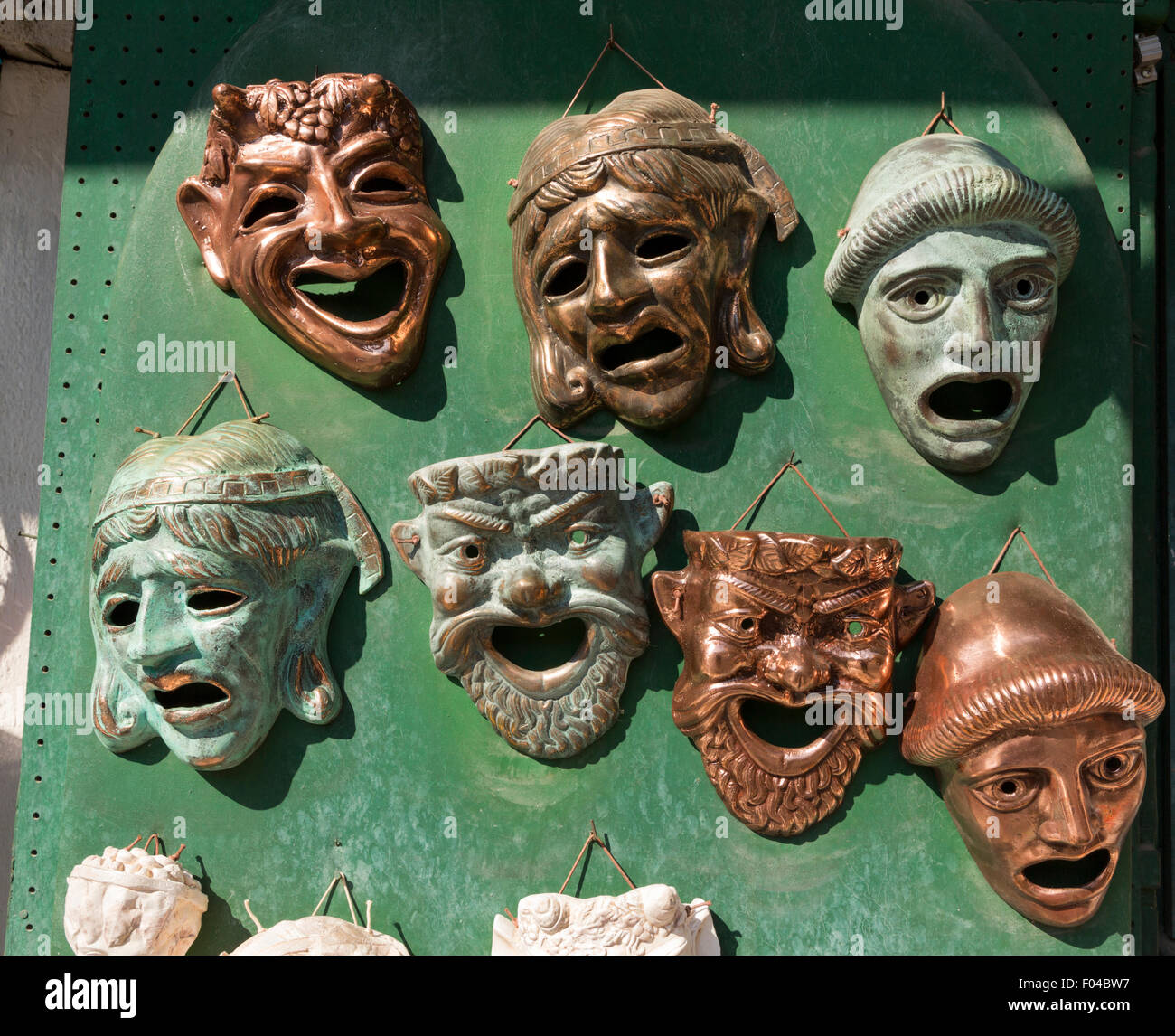 Comedy and Tragedy Masks on sale on Lysikratous in the Plaka neighborhood of Athens Greece - Stock Image