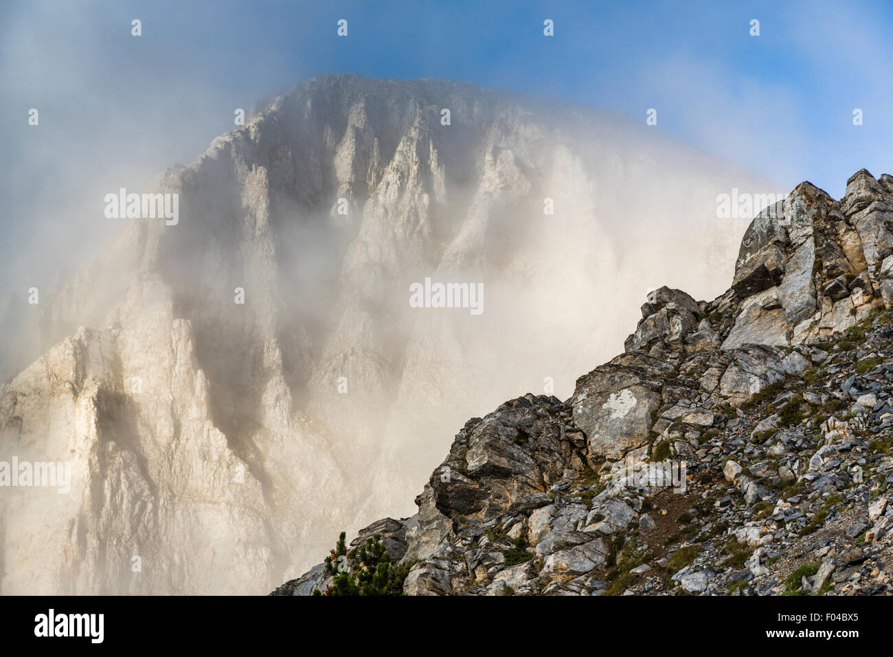 Summit of Mt Olympus, Greece emerges out of the clouds into sunshine - Stock Image