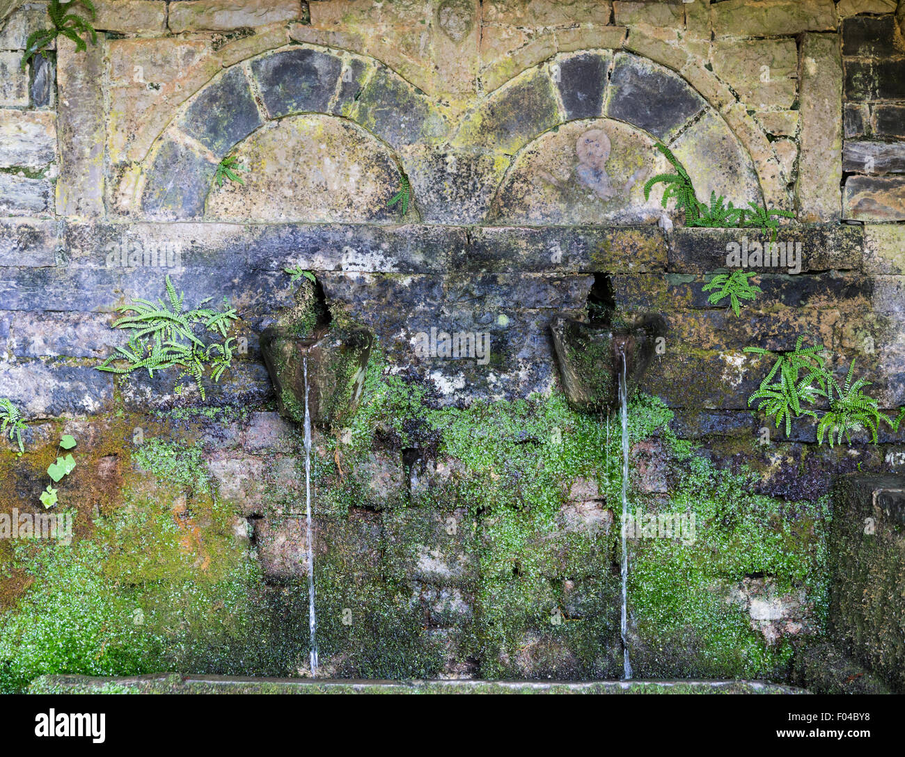 Spring water runs from a fountain in Vitsa, one of the stone villages of Zagoria, Greece - Stock Image