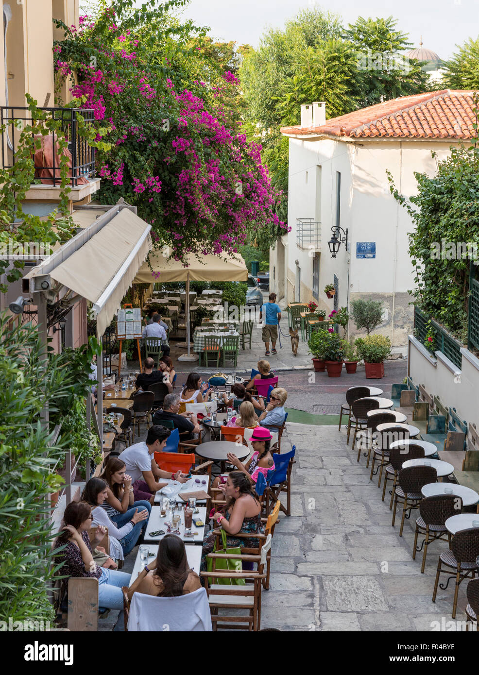 Diners at a cafe on Erechtheos in the Plaka neighborhood of Athens Greece enjoy food and drinks al fresco - Stock Image