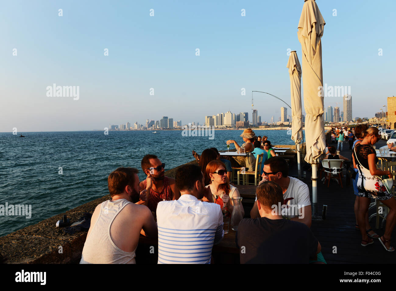 Friends drinking and Enjoying the views of Tel Aviv and the Mediterranean sea. - Stock Image