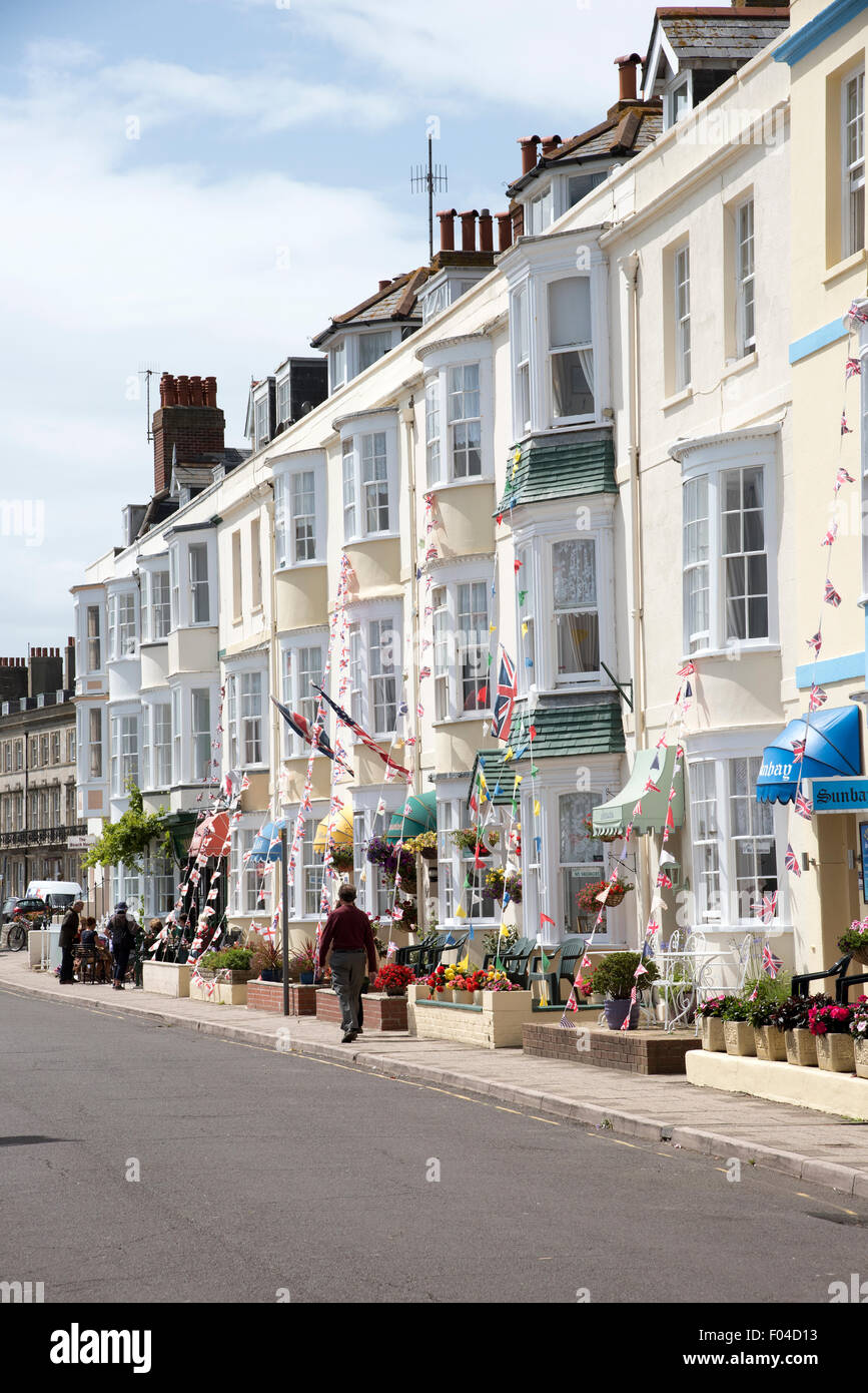 Seaside B&B establishments on a street of terraced properties in Weymouth Dorset England UK - Stock Image