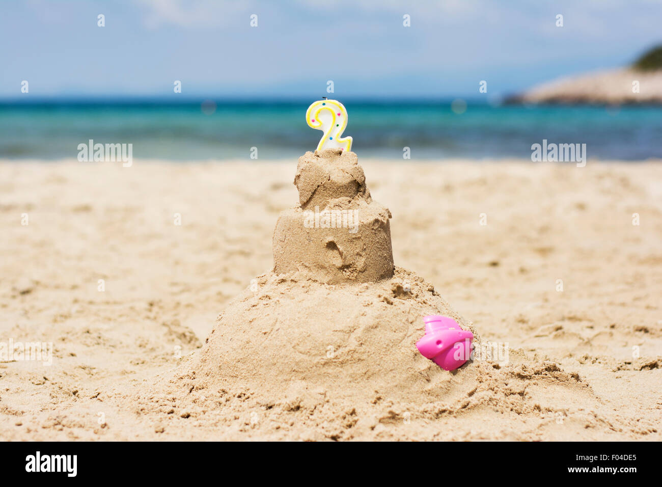 Awe Inspiring Sandy Birthday Cake With Candle Number Two On A Beach Stock Photo Funny Birthday Cards Online Necthendildamsfinfo